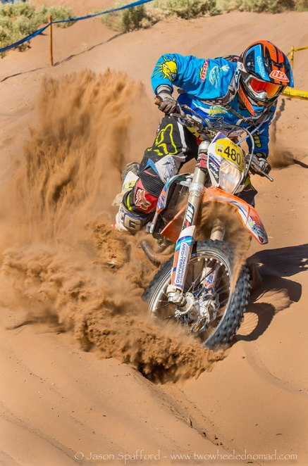 Enduro racer showing off his sand riding skills