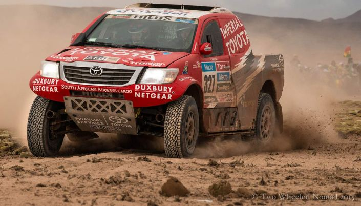 Cars bombing through the Dakar's seventh stage at La Chita, Bolivia