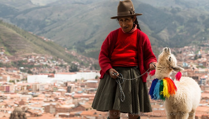 A local with her lucrative golden goose at the top of Cusco