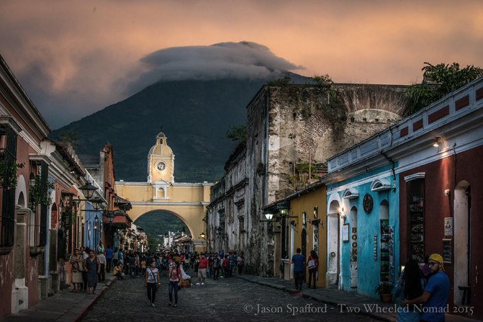 A quaint street in Antigua overlooking a massive volcanoe