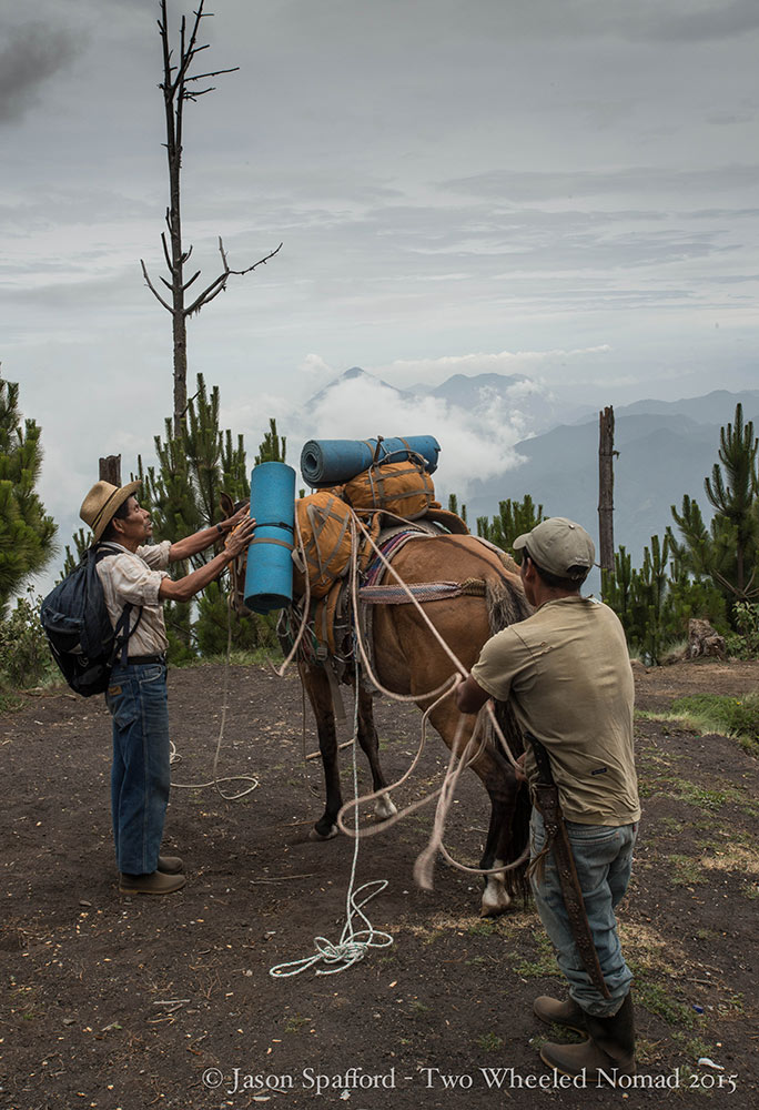 Two porters loading up Shakira, the sturdy and placid packhorse