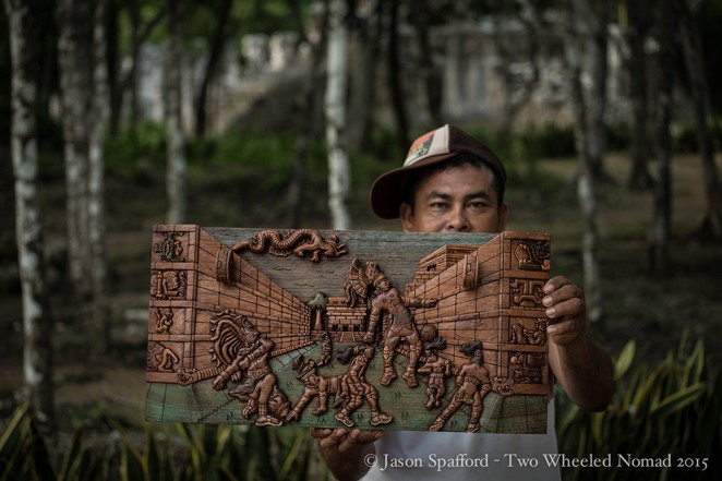 A vendor selling his wooden wares at Chichen Itza