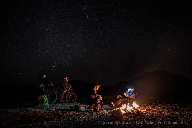 A day that ends in curling up to a good book around the campfire is one that becomes easily branded in the memories. (Quartzsite, AZ.)